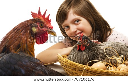 little girl with a hen and a rooster  - concept bio eggs