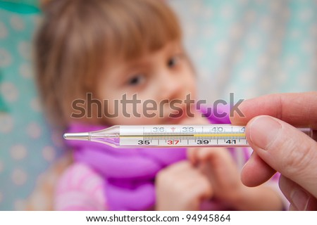 Little girl with a high temperature