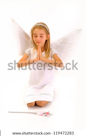 Little girl with a magic wand, depicts an angel who prays.