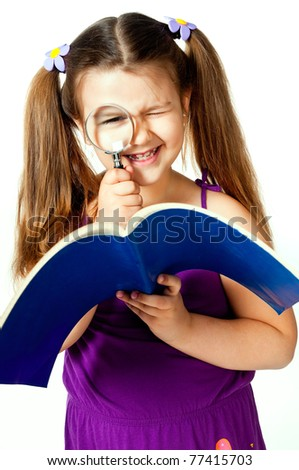 little girl with a magnifying glass on a white background