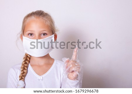 Little girl with a medical mask and disposable gloves. Antivirus. Coronavirus. Hygiene. Prevention Epidemic. Pandemic. The medicine. The fight against the virus. Virus. stock photo