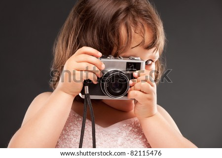 little girl with a old camera