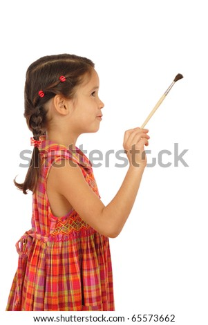 Little girl with a paintbrush, side view, isolated on white