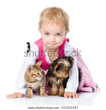little girl with a puppy and a kitten. isolated on white background