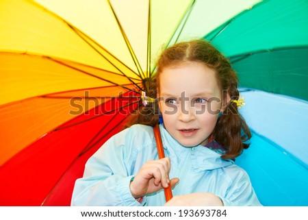 Little girl with a rainbow umbrella