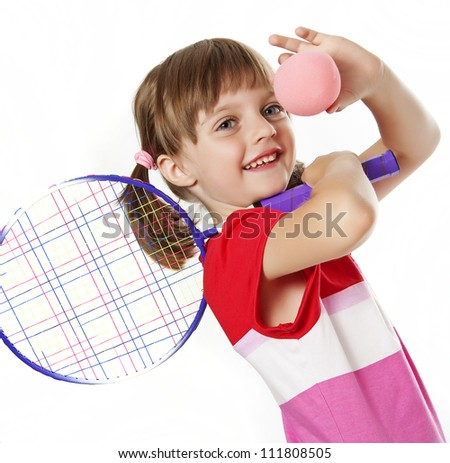 little girl with a tennis racket and ball isolated on white background