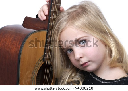 little girl with acoustic guitar
