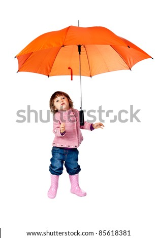 little girl with an orange umbrella in the studio on a white background