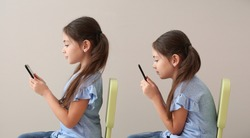 Little girl with bad and proper posture using mobile phone on grey background