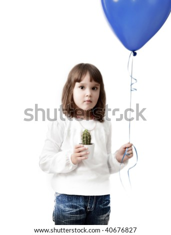 little girl with ball and cactus in hands over white background