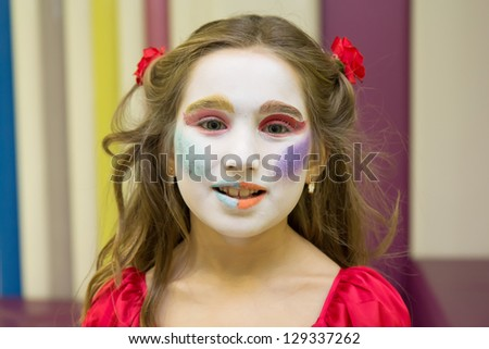 Little girl with body painted face