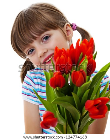 little girl with bunch of tulips