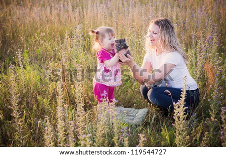 little girl with cats outdoor