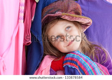 little girl with colorful clothes