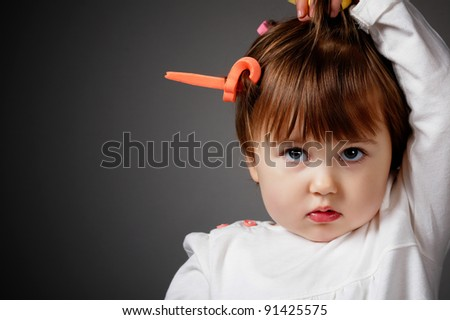 little girl with curlers