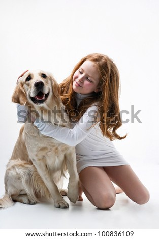 Little girl with dog on the white background