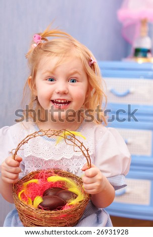 little girl with easter chocolate eggs