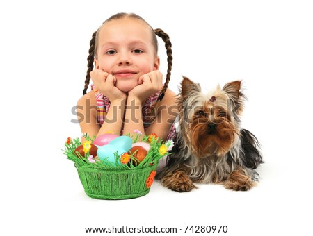 Little girl with easter eggs and dog