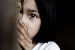 Little girl with eye sad and hopeless. Human trafficking and fear child concept.