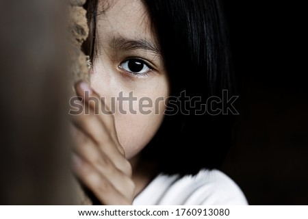 Little girl with eye sad and hopeless. Human trafficking and fear child concept.  Сток-фото ©