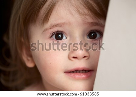 Little girl with eyes full of scare and sadness