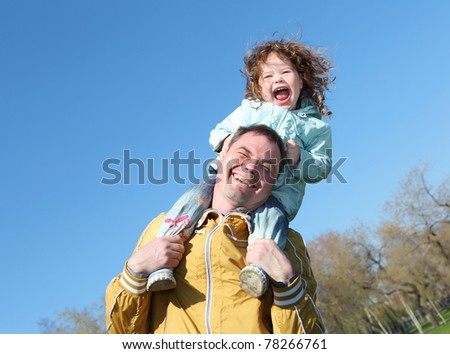 little girl with father in spring park