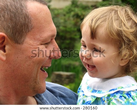 Little girl with father talking and laughing together