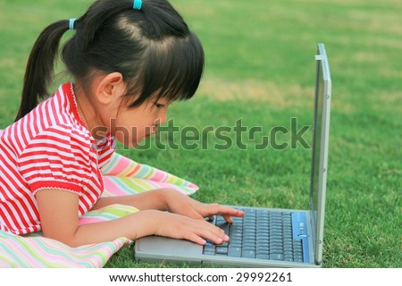 little girl with fingers on laptop