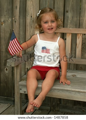 little girl with flag - soft focus - vintage look