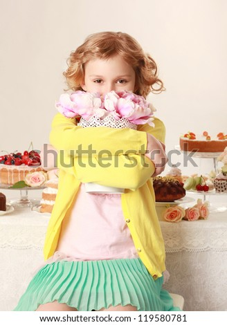 Little girl with flowers. Birthday party