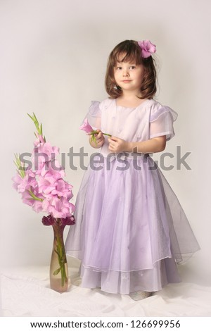 little girl with flowers gladiolus