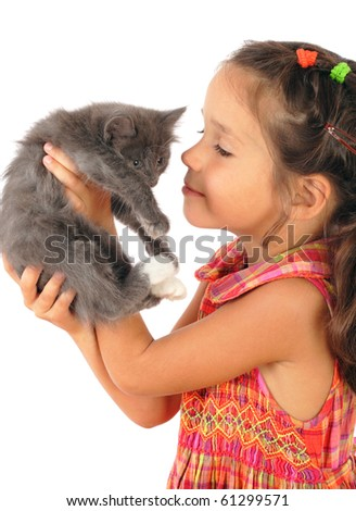 Little girl with gray kitty in hands, isolated on white