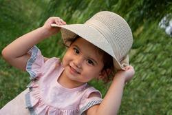 little girl with hat outdoor portrait