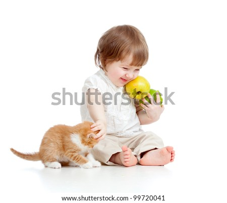 little girl with healthy food  playing with Scottish kitten - stock photo