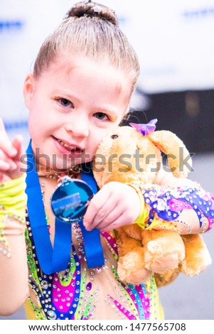 Little girl with her gold medal in figure skating figure skating. #1477565708