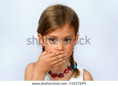 Little girl with her hand over her mouth