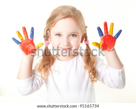 little girl with her hands painted
