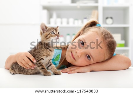 Little girl with her kitten - getting to know each other
