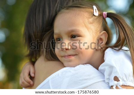 Little girl with her mother on a walk outdoors