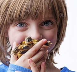little girl with her pet - tortoise