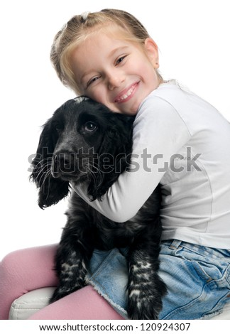 little girl with her puppy over white