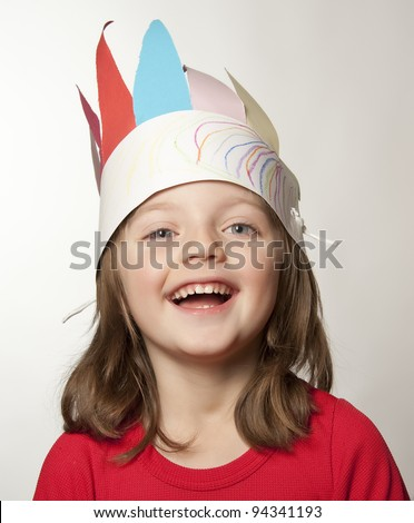 little girl with Indian headband made of colors paper - carnival mask