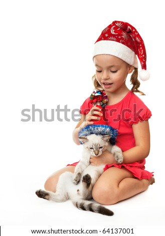 Little girl with kitten in Christmas hats. On the eastern calendar 2011 - the year the cat.