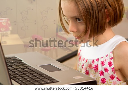 Little girl with laptop - media child