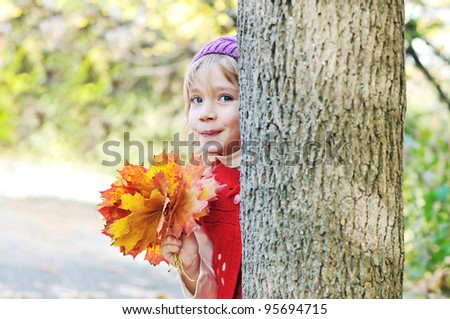little girl with leaves in forest - Peekaboo! I see you!