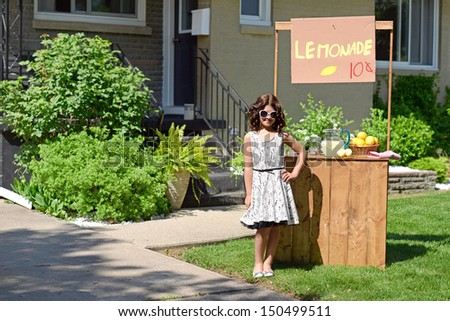 little girl with lemonade stand