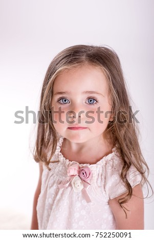 little girl with long hair in a studio on a white background   #752250091