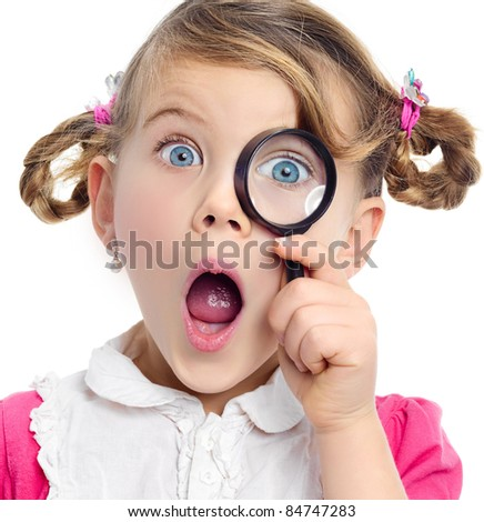 little girl with magnifying glass on white background
