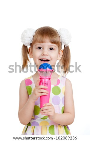 Little girl with microphone toy. Isolated on white background