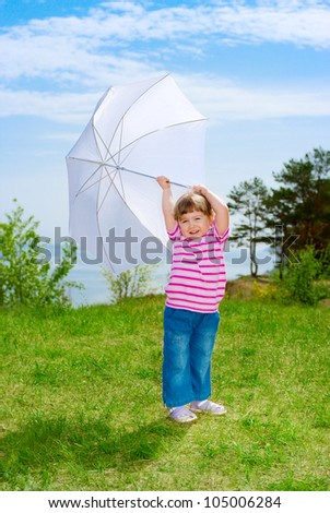 Little girl with parasol in forest